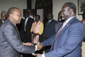 Kenya's President Uhuru Kenyatta (L) receives South Sudan's rebel leader Riek Machar, who was on a courtesy visit to the State House in Nairobi on May 29, 2014