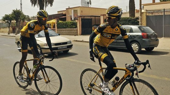 Jani Tewelde (L) and Meron Russom train in Asmara, the capital of Eritrea, on July 20, 2013. They are two of only six professional cyclists who compete internationally for Eritrea, a country more often associated with political repression than world-class athleticism. (AFP/File)
