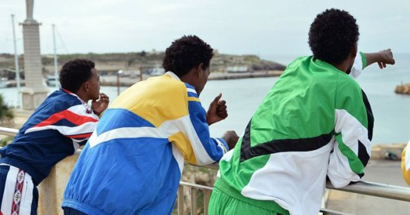 African migrants wait to board a ferry from Lampedusa to Sicily. Those transferred to Rome were given a welcome pack and accommodation