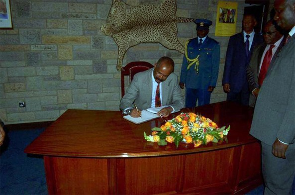 President signing on guest book