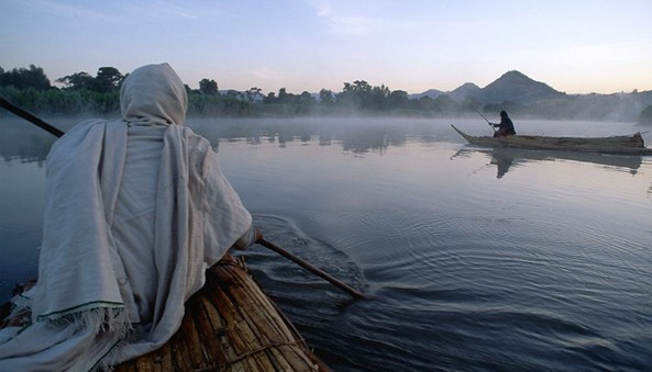 Papyrus reed boats cross the Blue Nile River in Ethiopia, where some people claim their water is being handed over to Saudi business interests.