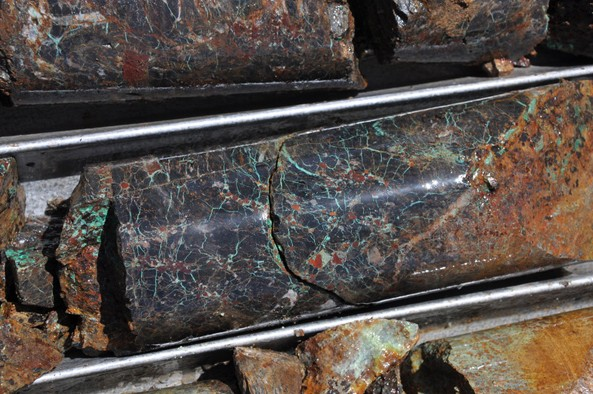 Green malachite stock-work with cuprite at approximately 8.0m depth in hole YDD-036