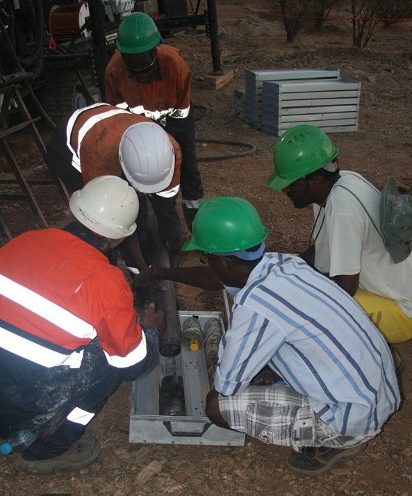 Colonnade Drilling's crew and Andiamo's Geologists emptying core barrel into a core tray