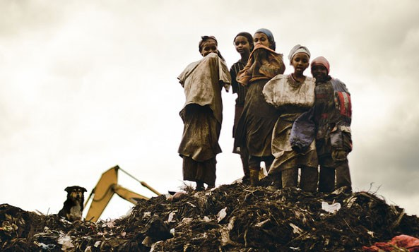 British journalist Caroline Knowles writes that Addis Ababa's city dump (aka Koshe) is the only source of survival for many Ethiopians. Koshe Dump is where Ethiopia's ruling class, the Woyanne, shares its wealth with the poor.