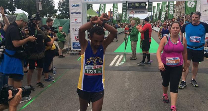 Quebec City Marathon Winner Replicates Olympic Medallist's Political Protest