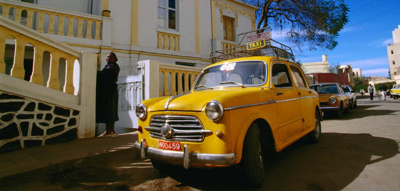 Yellow-fiat taxis ply the streets of Asmara