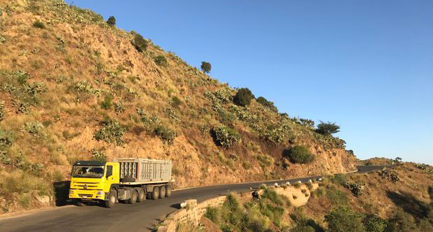 A truck carries mineral concentrate from the Bisha mine to Massawa port